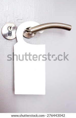 White signal hanging on a door handle of hotel rooms - stock photo