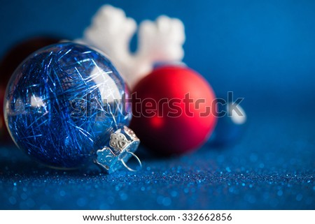 White, silver and red christmas ornaments on dark blue glitter background with space for text. Merry christmas card. Winter holidays. Xmas theme. - stock photo