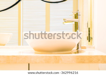 White sink faucet decortaion in Bathroom interior - Filter effect - stock photo