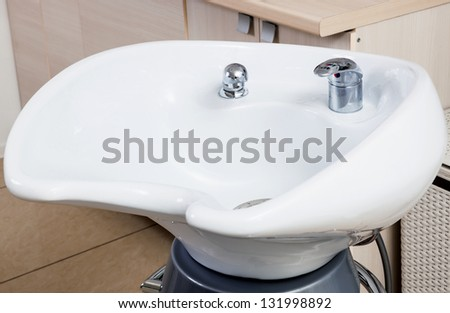 white sink in a modern barber shop