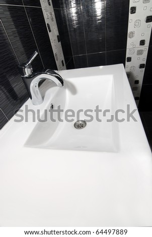 white sink with chrome faucet - stock photo