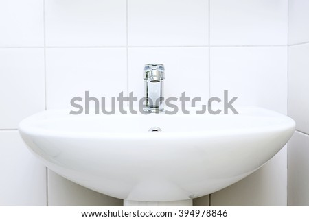 White sink with faucet, hygiene and cleanliness, Water in the sink - stock photo