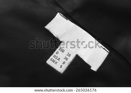 White size label on black cloth as a background - stock photo