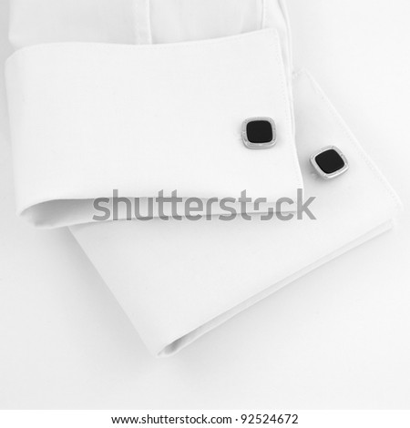 White sleeves with black cuff-links - stock photo