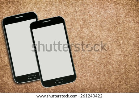 White smart phone with isolated screen on old wooden desk. - stock photo