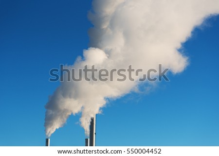 White smoke in blue sky.