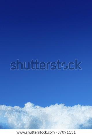 White snow and deep blue sky - stock photo