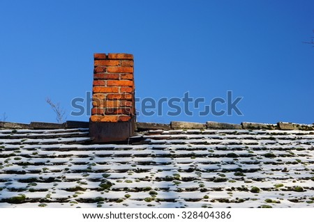 White snow on a house roof - stock photo