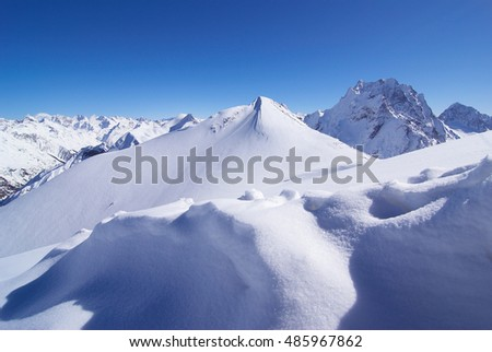 white snow on a sunny day in the mountains