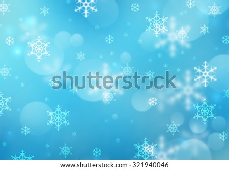 White snowflake on blue defocused background with bokeh effect. Blurred elegant snow flakes are falling. Holidays New Year or Christmas snowy card concept. Elegant and beautiful winter background. - stock photo