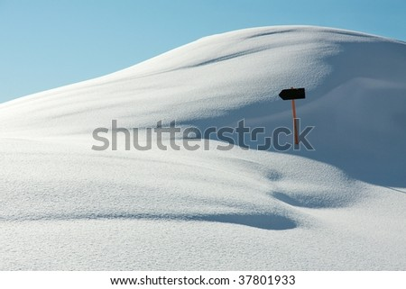 White, snowy landscape with a direction sign - stock photo