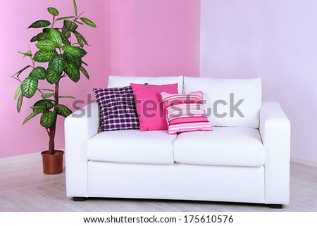 White sofa in room on pink wall background - stock photo