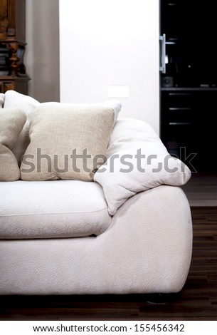 white sofa near the brown wall - stock photo
