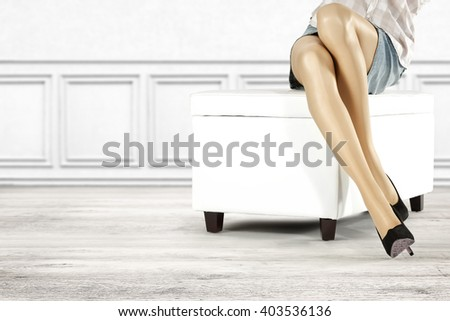 white sofa on floor and free space and woman legs