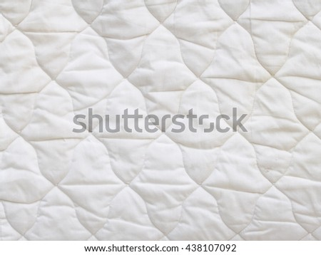 white soft cotton summer abstract patchwork pattern blanket hanging after wash in laundry   - stock photo
