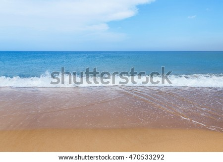 white soft wave on empty tropical beach in sunny day