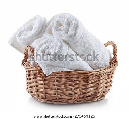 white spa towels in a basket isolated on white background - stock photo