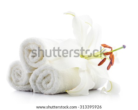 White spa towels with lily flower isolated on white. Spa concept - stock photo