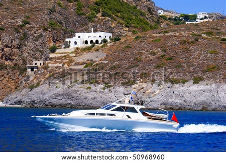 White speedboat shot from above while travelling fast, Greece - stock photo