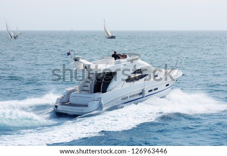 white speeding motor yacht - stock photo