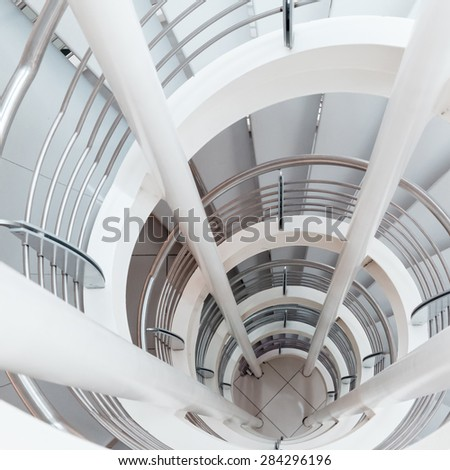 white spiral staircase in a modern building - stock photo