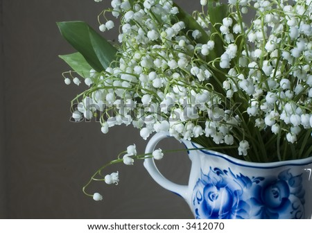 White spring flowers in a colorful cup - stock photo