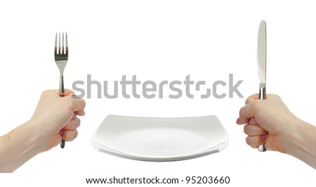 white square plate, knife and fork cutlery in hands isolated - stock photo