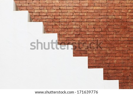 white stairs on brick wall - stock photo