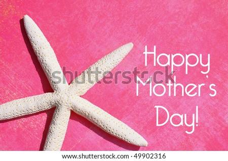 White starfish on pink background - stock photo