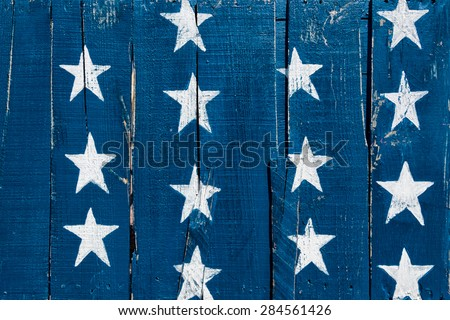 White stars on blue painted on rustic wood boards. Background for July 4th, Memorial Day, Veterans Day or other patriotic occasion. - stock photo