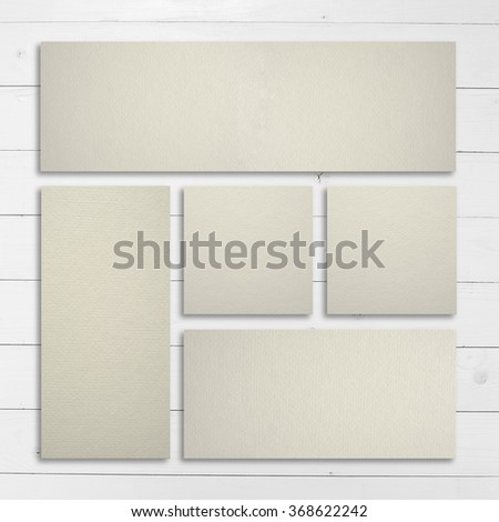 White stationery template over wooden background