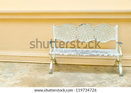 White Steel Bench at front wall - stock photo