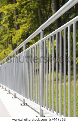 white steel fence railing outdoor - stock photo