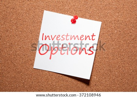 """White sticker on the pin up board. Written in red marker text """"Investment Options"""" Internet concept. Business concept. - stock photo"""