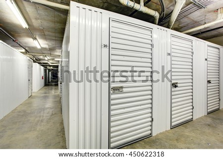 White storage units in the basement for apartment building & White Storage Units Basement Apartment Building Stock Photo (Safe to ...