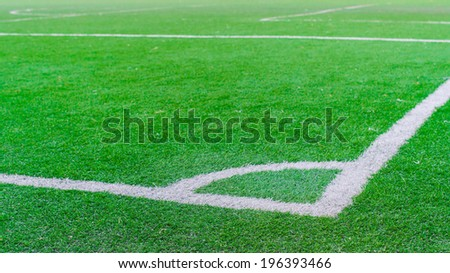 White stripe on the green soccer field from top view. - stock photo
