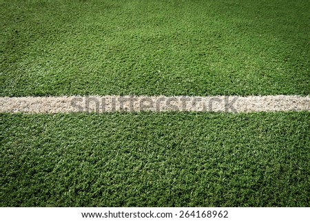 White stripe on the green tennis field from top view - stock photo