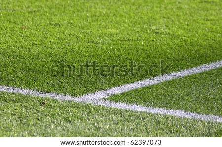 White stripes on the green soccer field - stock photo