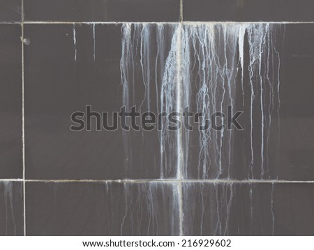 white stripes translucent lime flow down the gray street tile  - stock photo