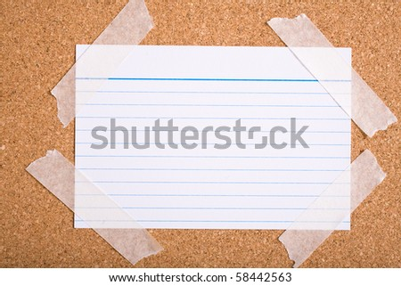white stripped note card on cork board - stock photo
