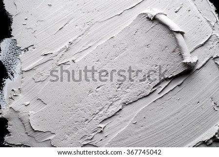 white Structural plaster on black wall - stock photo