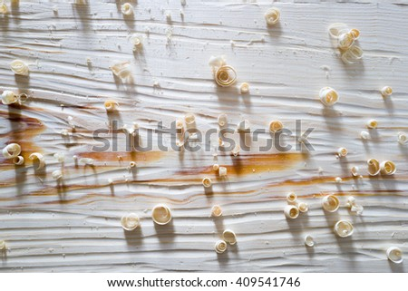 white structure of a pine on board with sawdust - stock photo