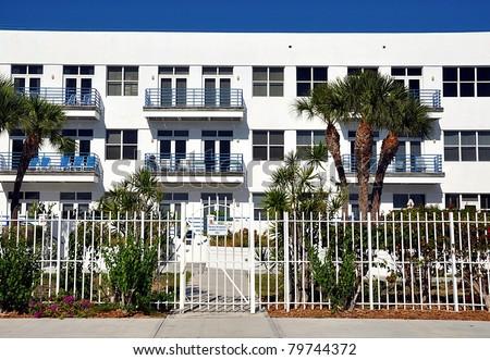 White Stucco Condominium Building - stock photo