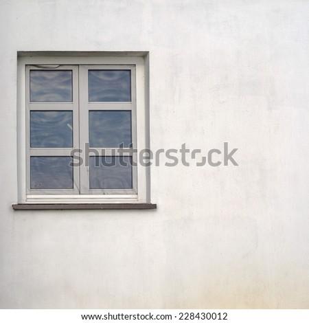 white stucco grunge wall with window background - stock photo