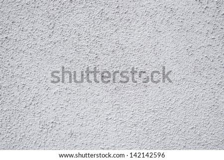 White stucco rough textured background shot. - stock photo