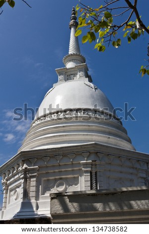 White stupa in the Seema Malaka Temple in Colombo. This is situated on Beira Lake and is part of the Gangaramaya Buddhist Temple Complex. - stock photo
