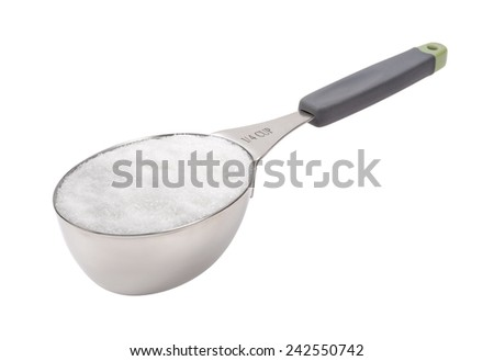 White Sugar in a Measuring Cup. Isolated on white with a clipping path. The image is in full focus, front to back. - stock photo