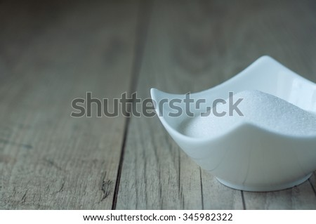 white sugar in white bowl