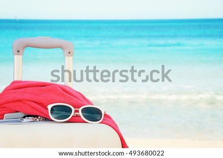 White suitcase on sea backround, Concept of summer traveling