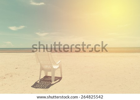 White sun chair on beach of Thailand. Vintage filter. - stock photo